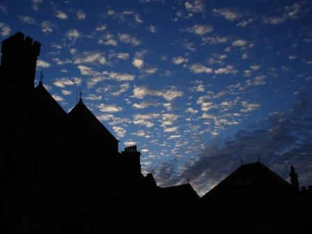 Silhouette of haunted Castle Craig y Nos, Swansea, Wales, at night with moonlit clouds