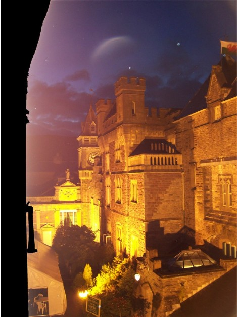 Moon above floodlit Haunted house Craig y Nos castle Wales