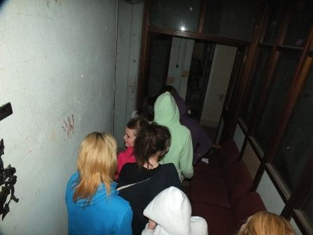 Swansea Ghost Hunting teenagers on a teen's terror night corridor at Craig y Nos Most Haunted Castle Wales