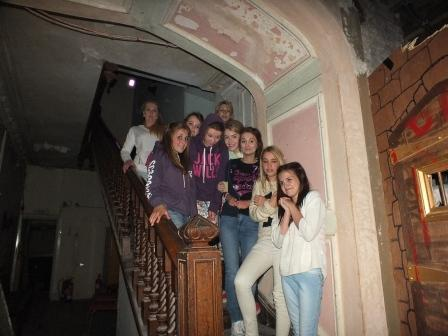 Teenagers Fright Night  children on staircase at Craig y Nos Most Haunted Castle Swansea Wales