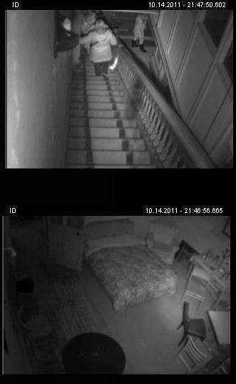 Ghost Hunters descend the haunted staircase at Craig y Nos Castle in Powys, Wales