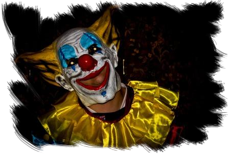 Childrens Fright Night clown in yellow white painted joker face at Craig y Nos Most Haunted Castle in Wales