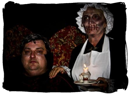 Childrens Fright Night Steve Graham Paranormail Invesigations Dracula edwardian costumed 'muted maid' holding candle at Craig y Nos Most Haunted House in Swansea South Wales