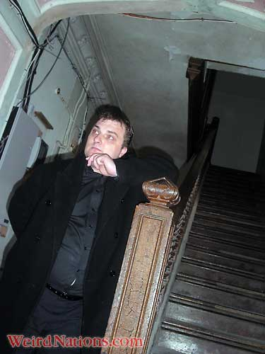 Steve Graham, Paranormal Investigations leader, on staircase of Haunted Castle Craig y Nos, Swansea, Wales